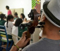 Educational Center Volunteer Playing Song