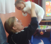 Educational Center Volunteer Playing with Baby